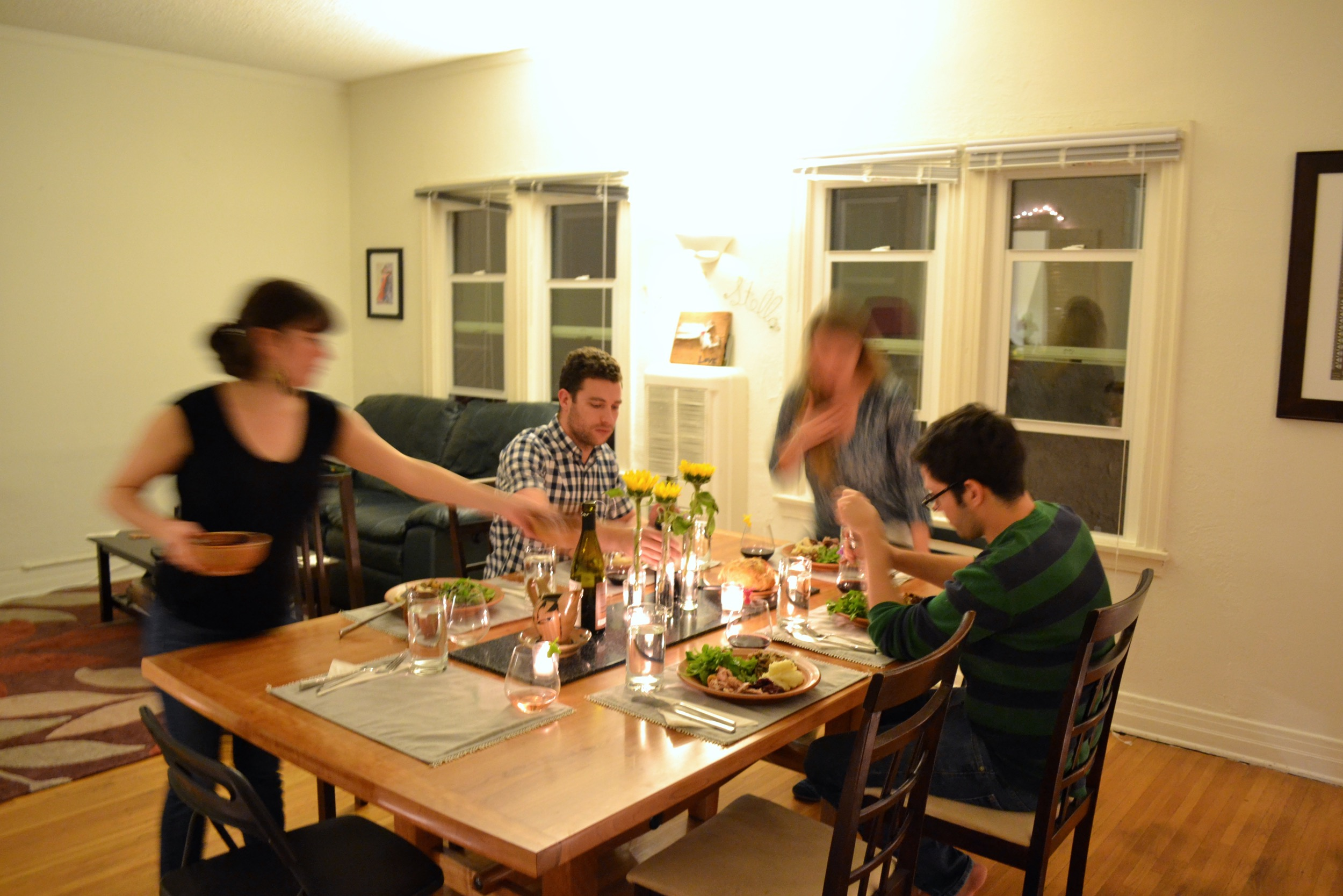 I love this shot - How everyone is swirling around the two already seated at the table.