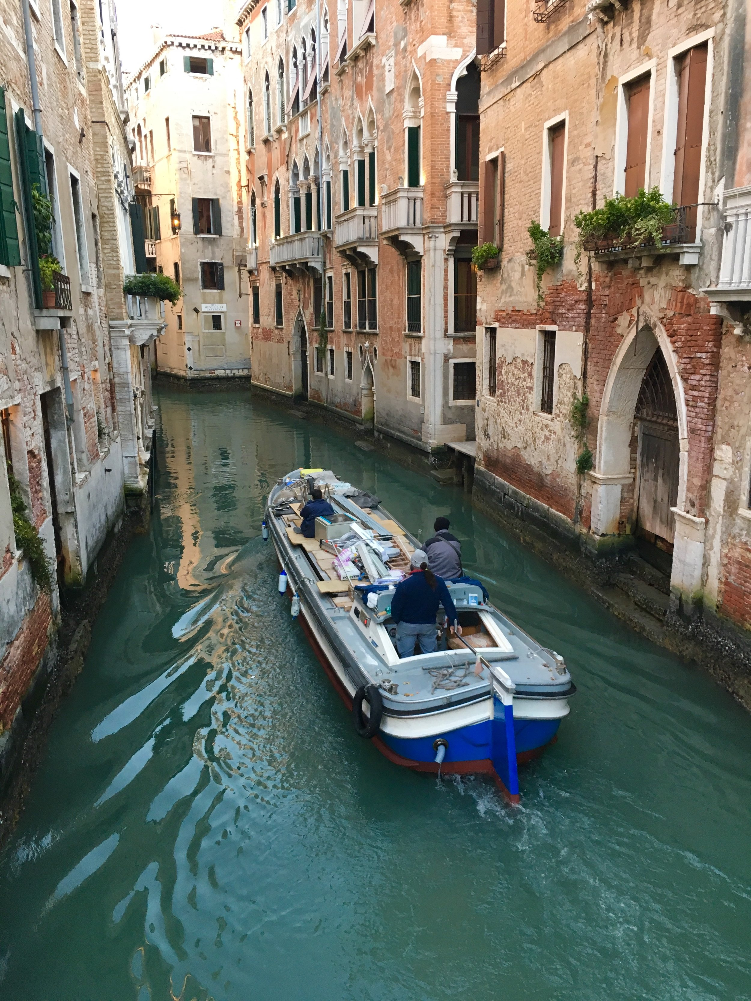 There are no cars allowed in Venice, so even the construction workers have to get around by boat!