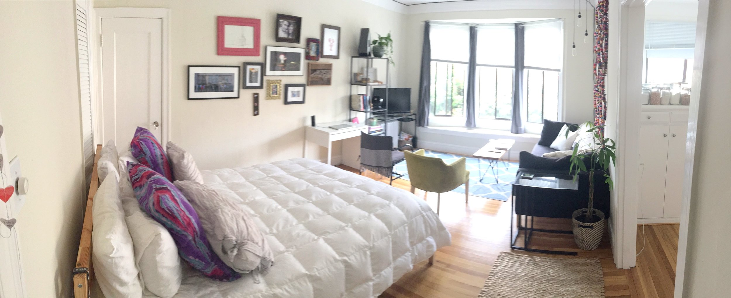 A grainy iPhone photo of our studio apartment, for the full room.