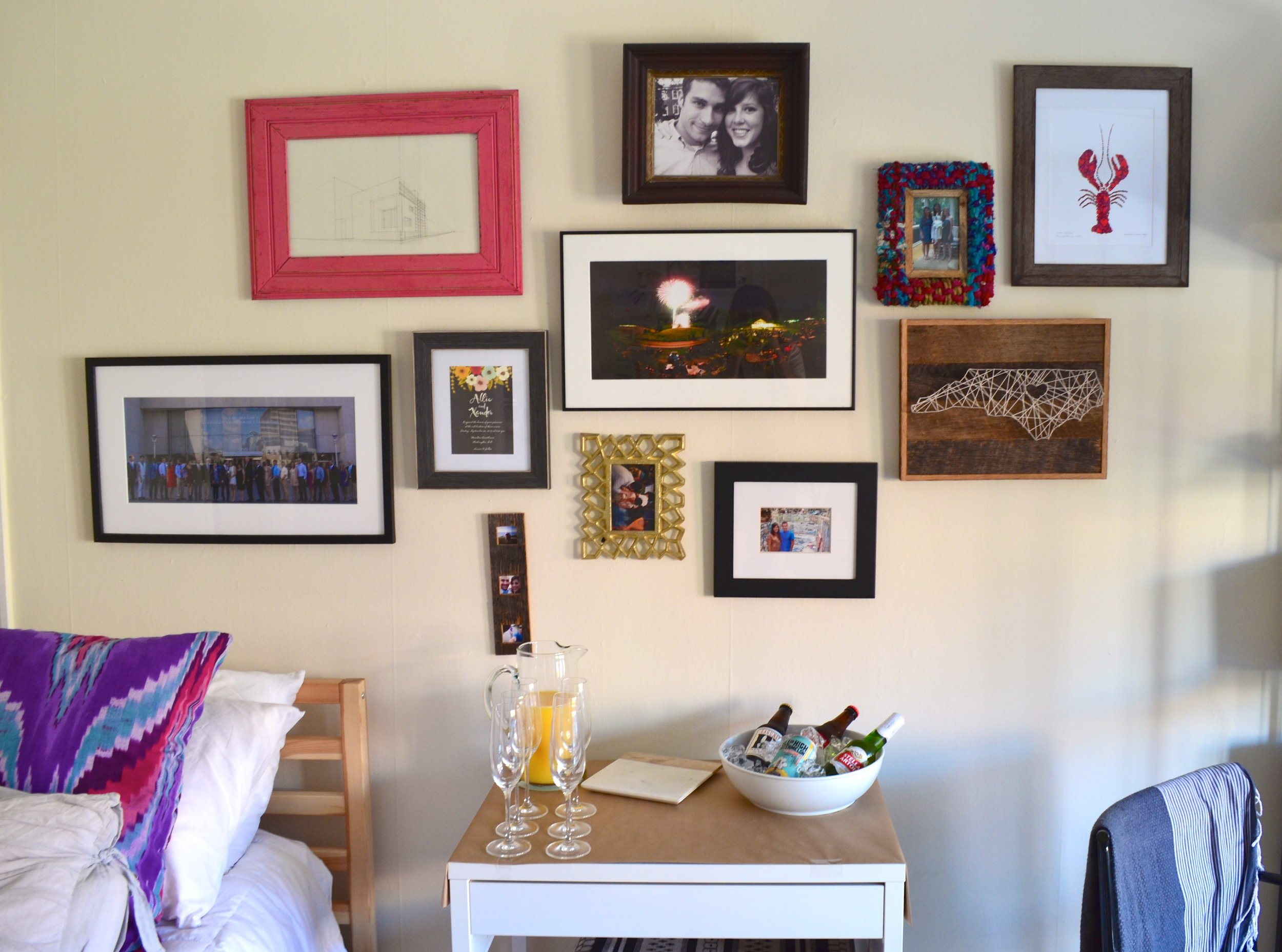 An up-close photo of (most) of that same gallery wall. The apartment was rearranged so we could fit 10 people when  we hosted a wedding shower .