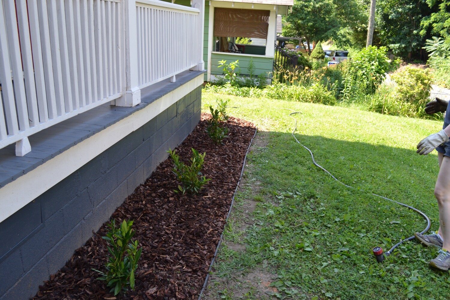 We used 8 bags of large pine bark mulch and created a thick layer on top of the landscape cloth.