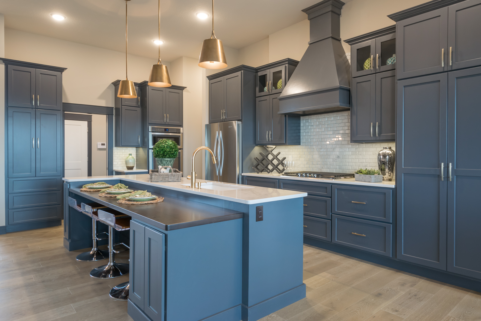 Our breakfast bar at our model home is the perfect space to finish up any school work!