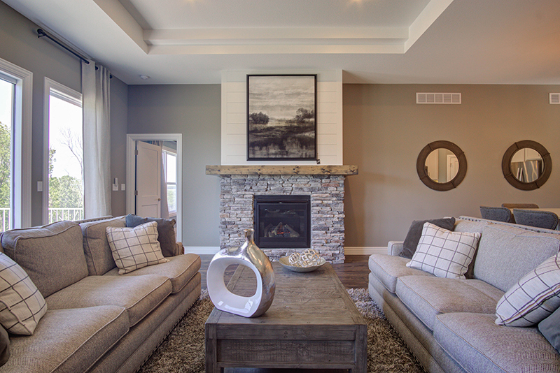 Tall ceilings and large fireplace adorn this beautiful new home in Columbia MO