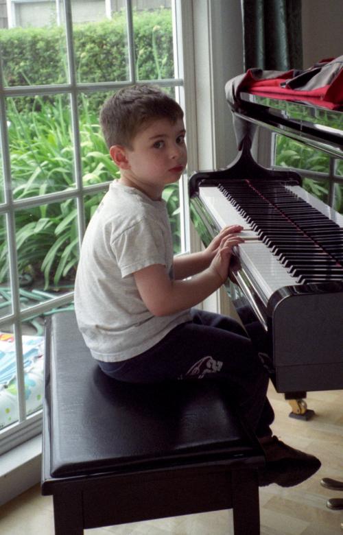 Justin at piano.jpg