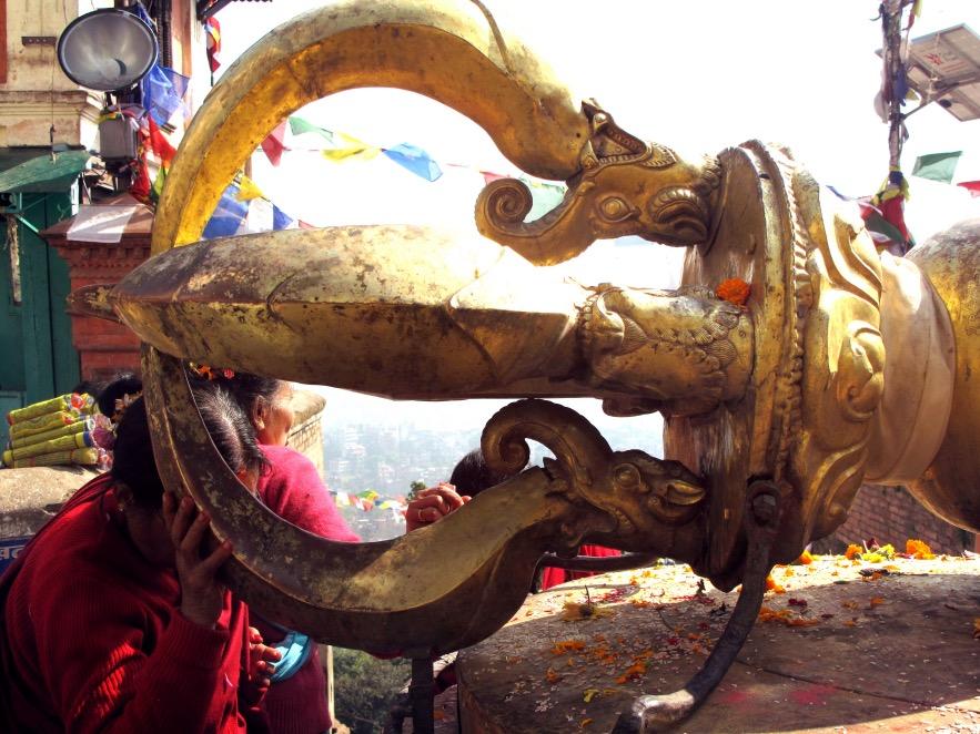 Kat_woman praying on statue.JPG