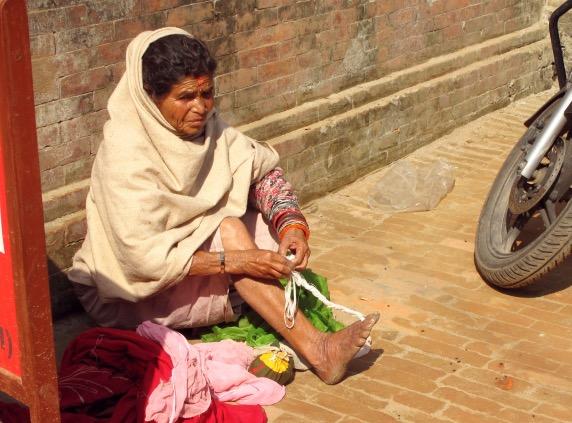 Kat_Woman knitting with toe.JPG