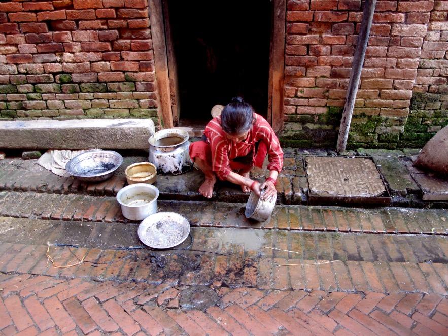 Kat_Lady washing  up in red.JPG