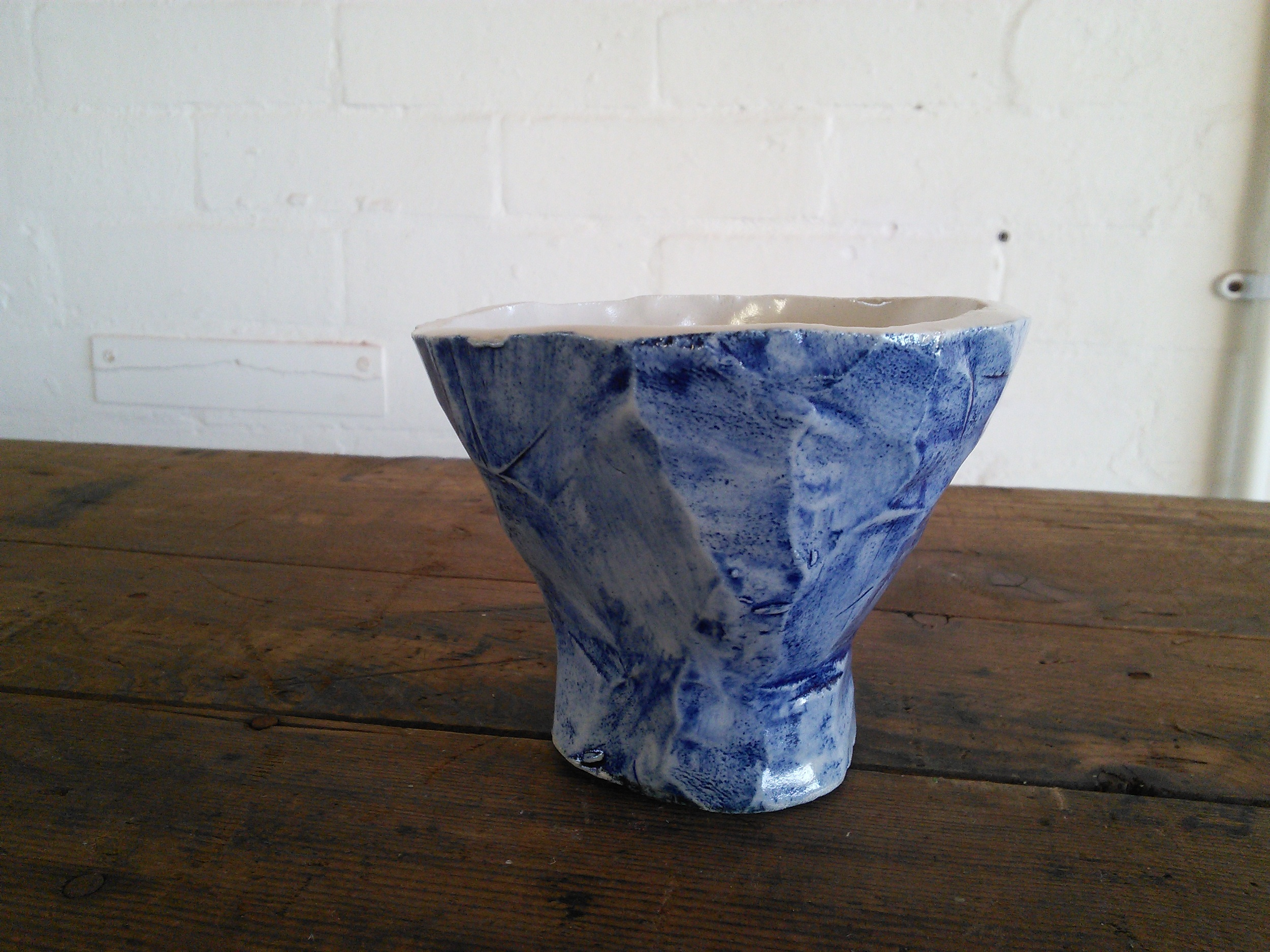 Pinched and faceted pot with cobalt wash, J