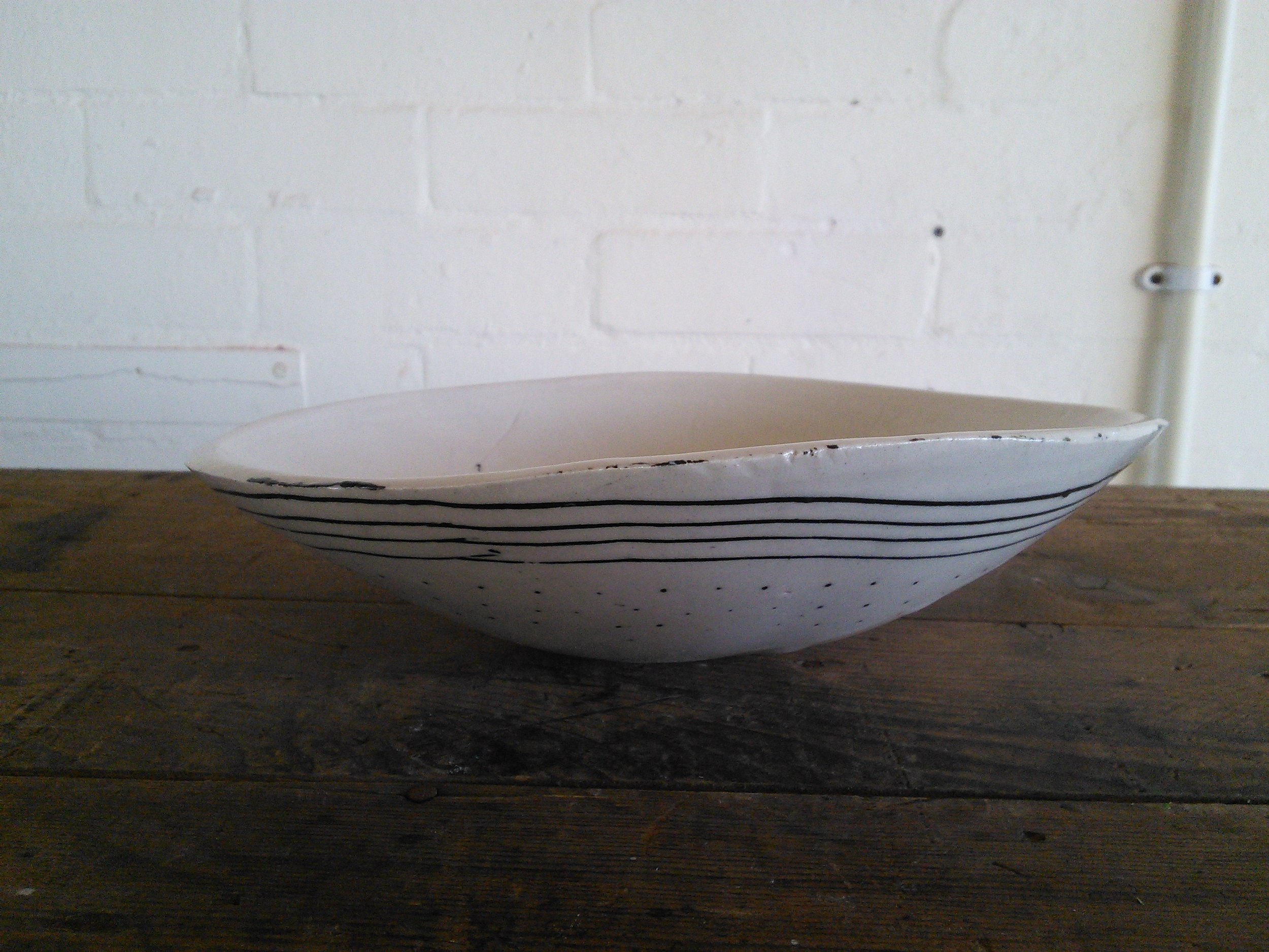 Moulded slab bowl with inlaid design, F
