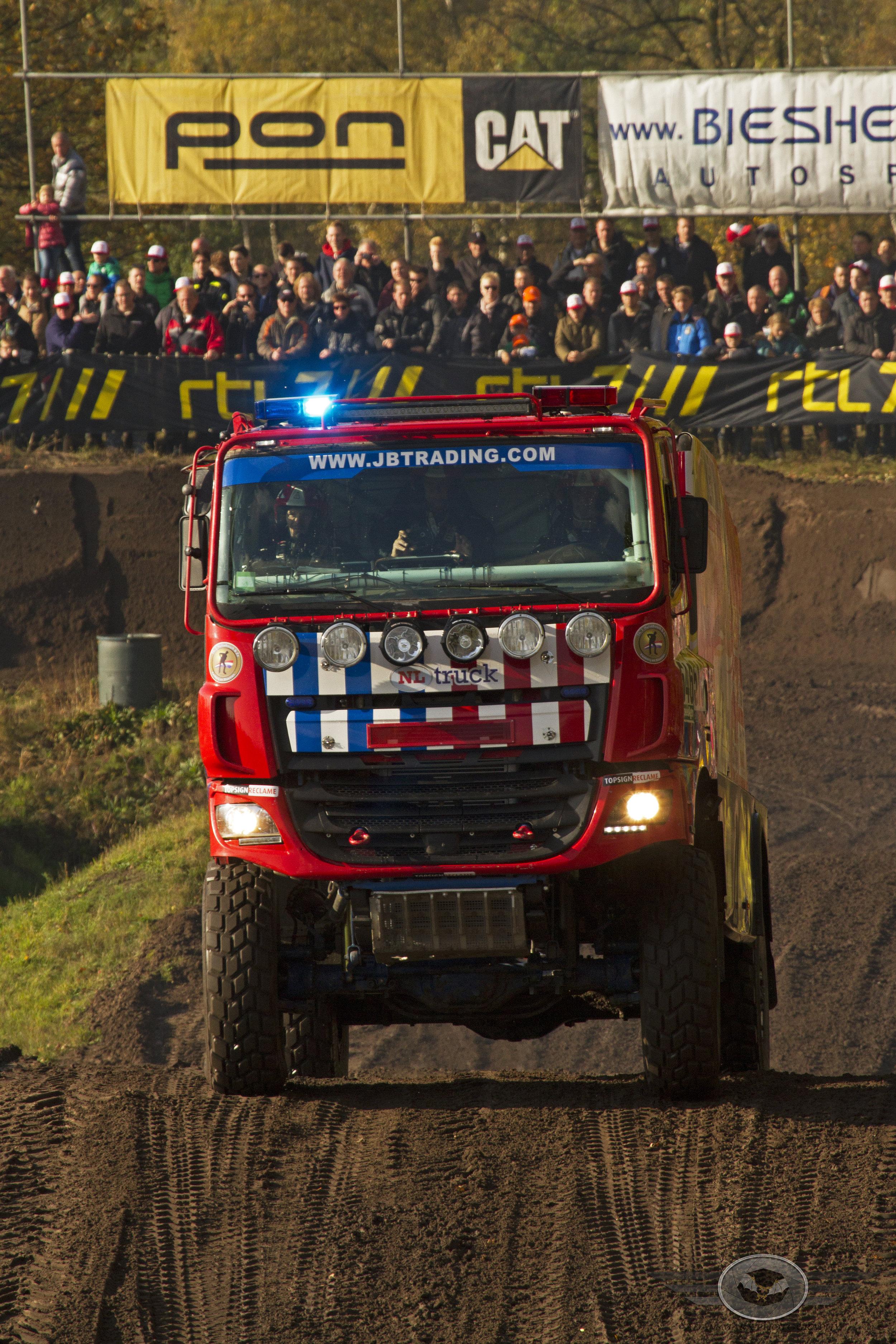 Blue lights on for Richard de Groot in his Dakar firetruck.