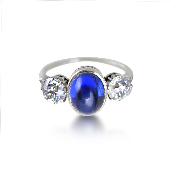 CABOCHON SAPPHIRE AND DIAMOND THREE-STONE RING