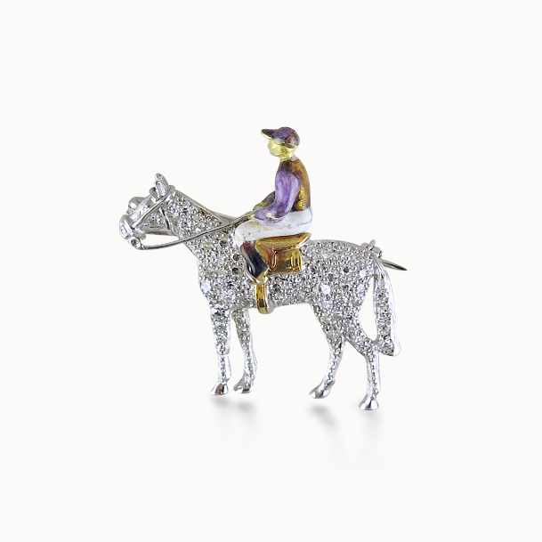 DIAMOND AND ENAMEL HORSE AND JOCKEY BROOCH