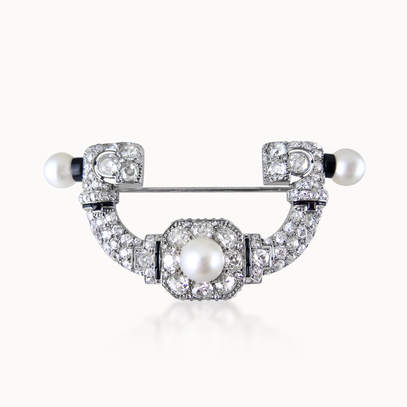 DIAMOND, PEARL AND ONYX BROOCH BY CARTIER PARIS