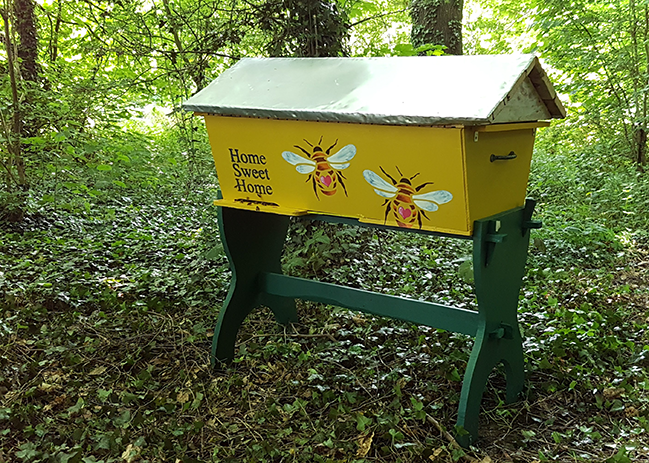 Our top bar hive, built by Andrew and painted by Emma!