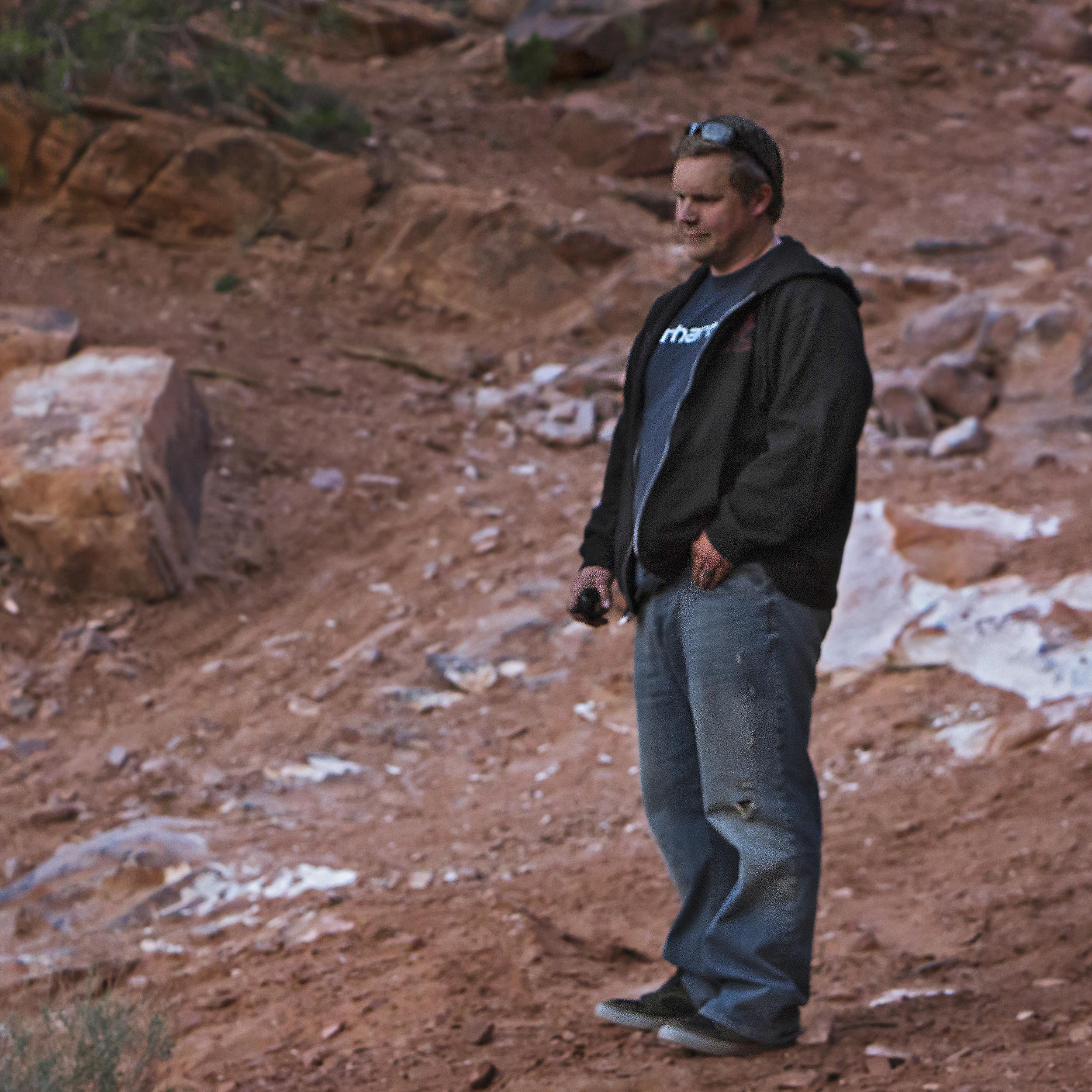David Wakely looks down Rose Garden Hill near Moab, UT