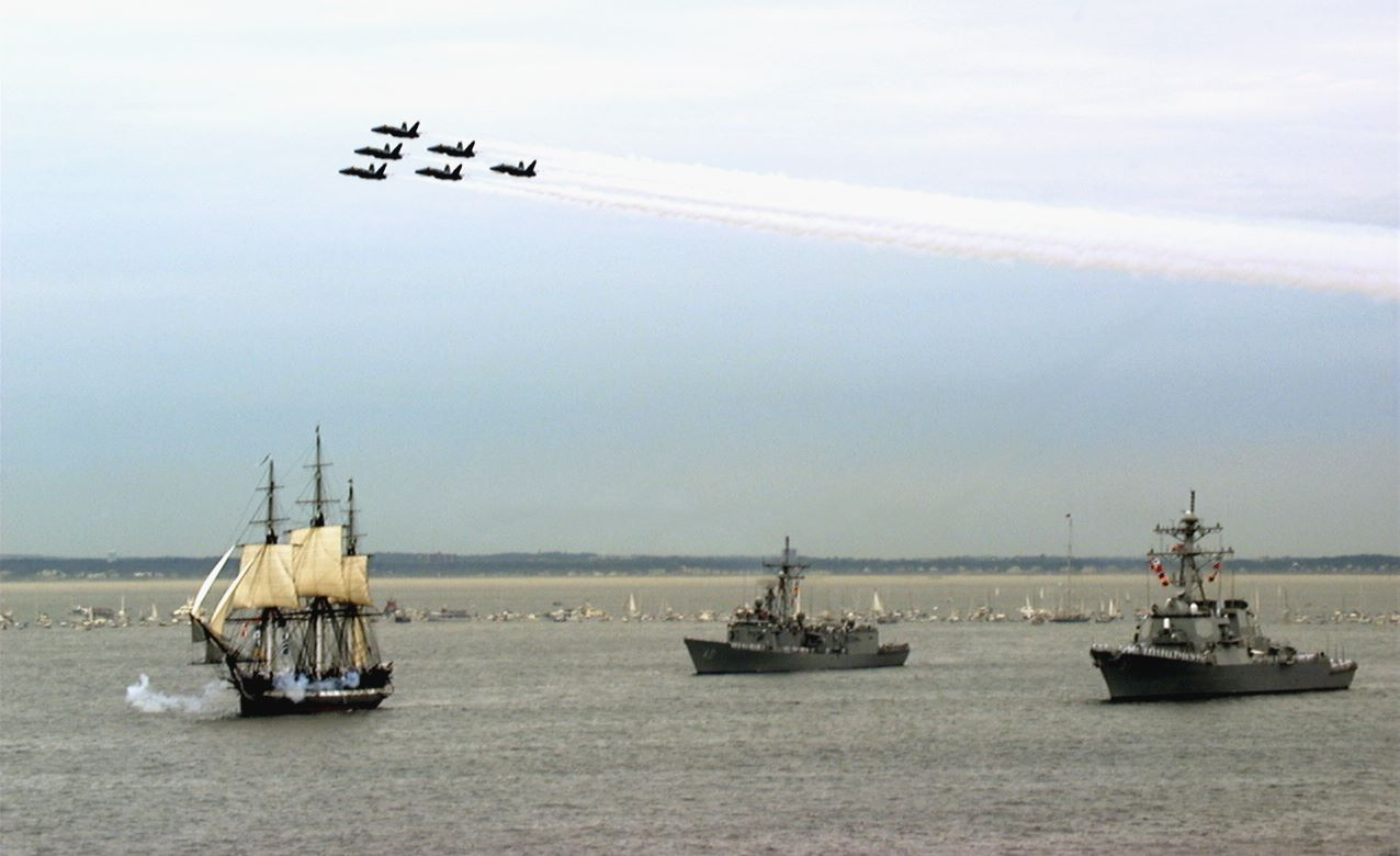 Image: USS Constitution setting sail at her 200th anniversary in 1997, with destroyer USS Ramage, frigate USS Halyburton and the Blue Angels.