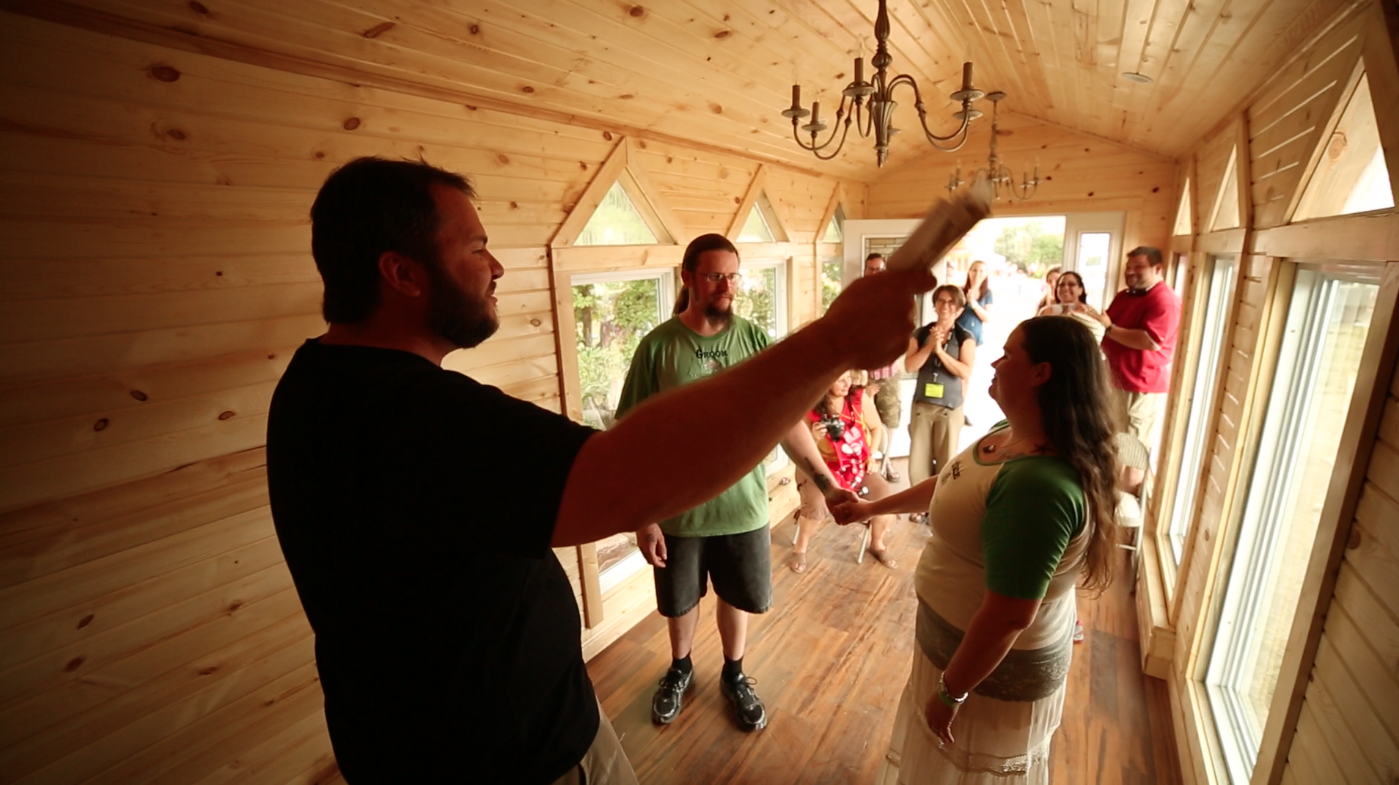 Meg & Brandy of TinyHouse43 renew their wedding vows in the Mini Chapel. Andrew Odom officiates.