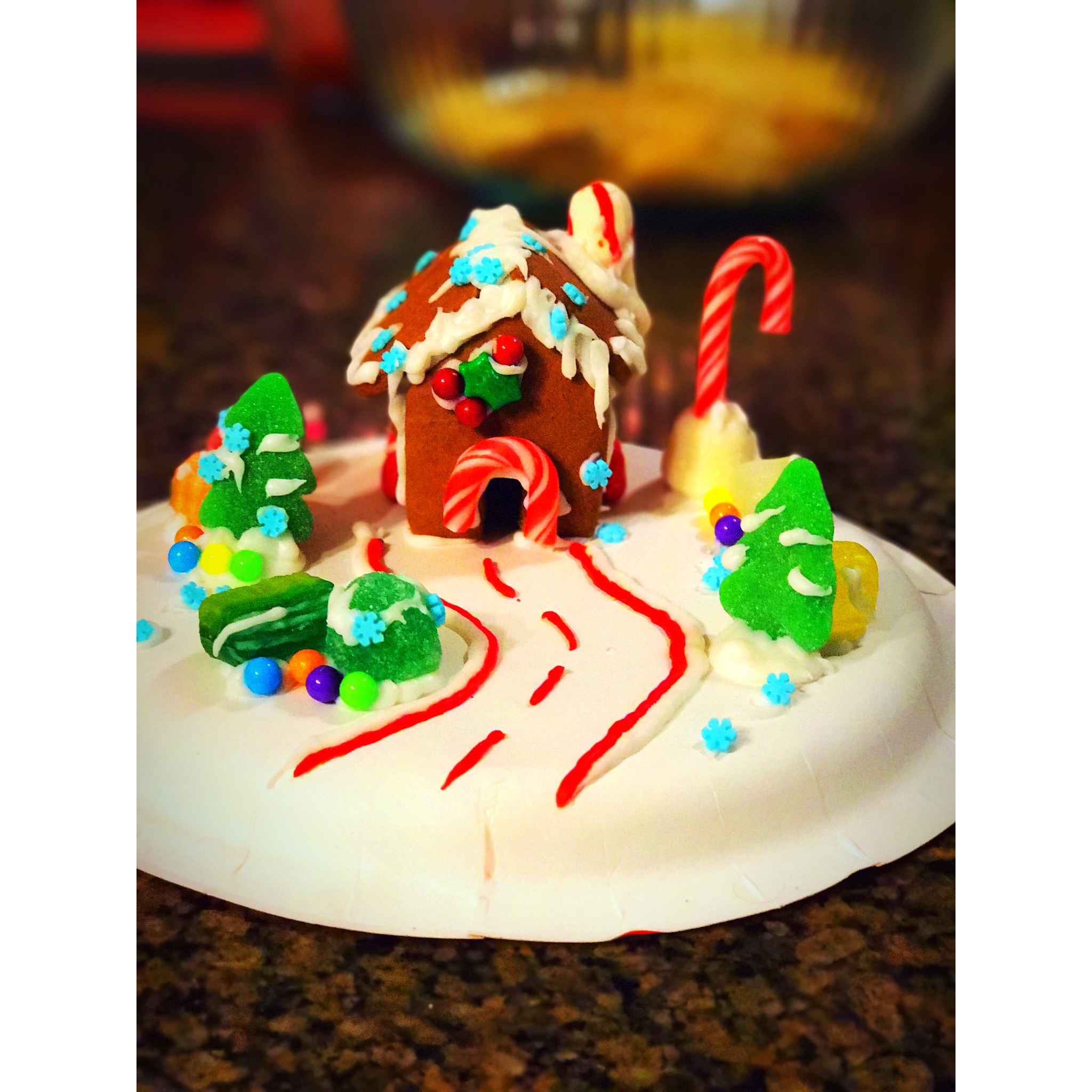 Tiny gingerbread house on wheels