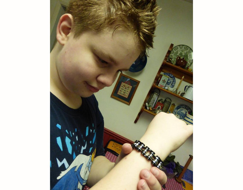 H, with a bike chain bracelet