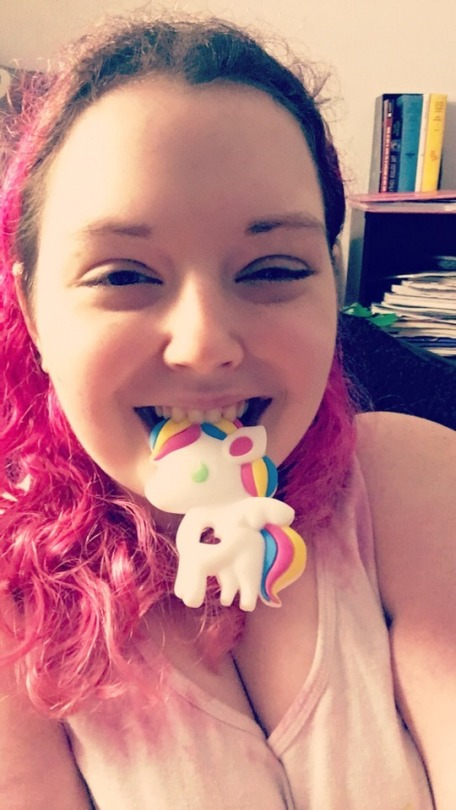 Morgan, with a chewable unicorn