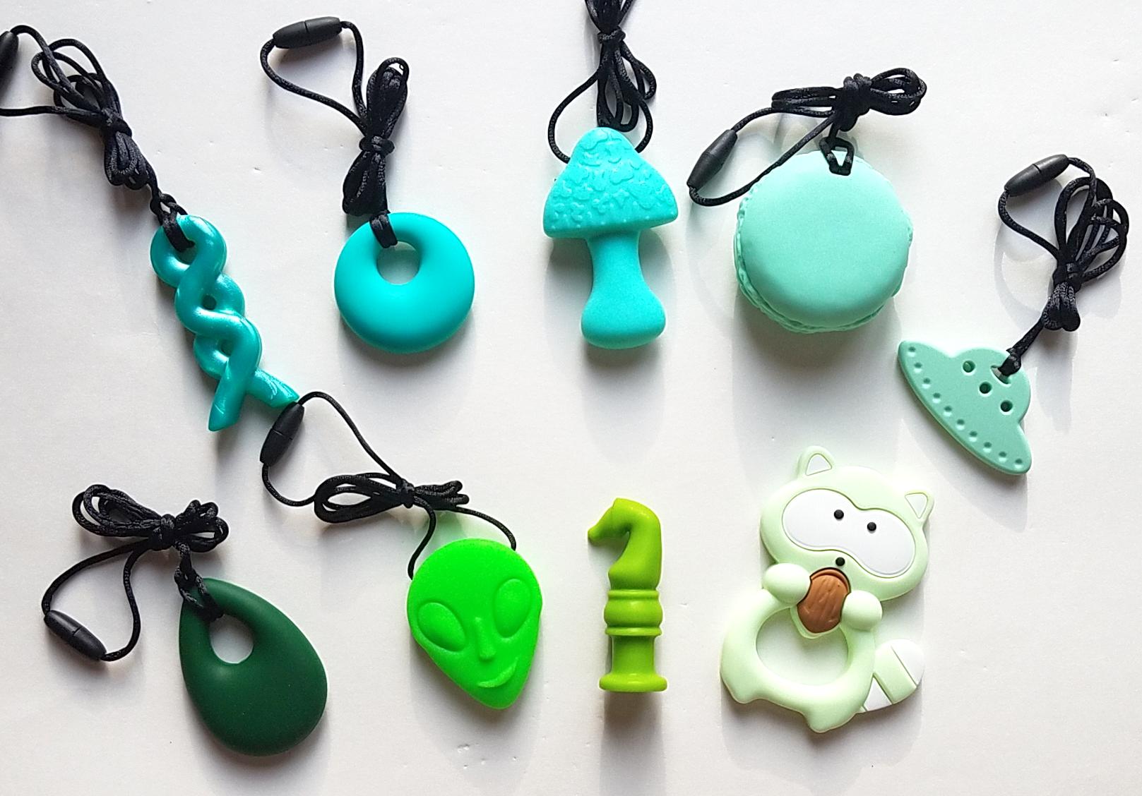 Clockwise from top left: Azure braid, turquoise annular, mint mushroom, green macaron, mint UFO, green raccoon, lime green chew knight, neon green alien, emerald droplet.