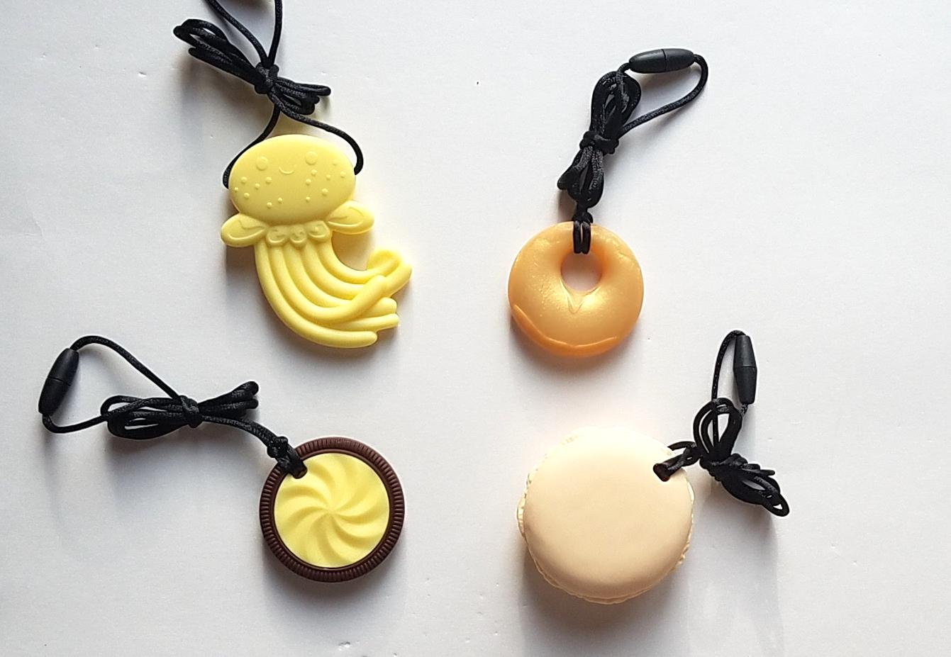 Clockwise from top left: Yellow jellyfish, gold annular, yellow macaron, lemon yellow cookie.