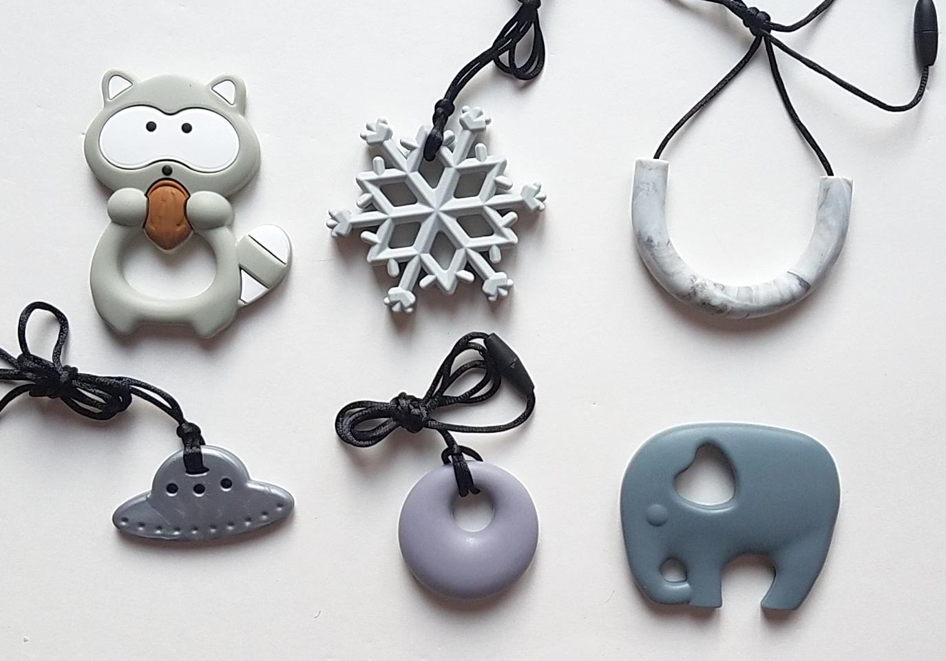 Clockwise from top left: Grey raccoon, grey snowflake, marble grey Ch-U tube, grey elephant, grey annular, silver UFO.