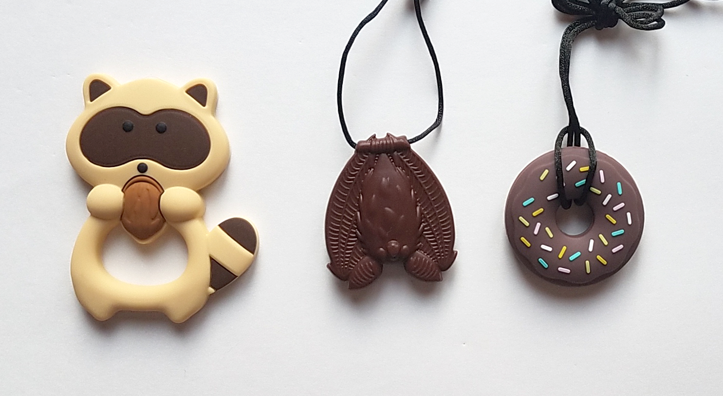 From left: brown raccoon, brown bat, brown donut.