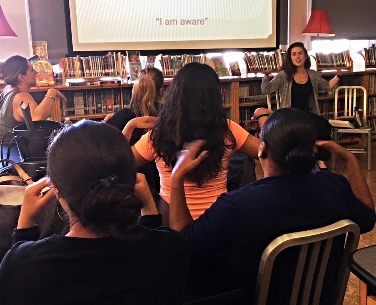 Alison leading an introductory mindfulness workshop for elementary school staff in Brooklyn