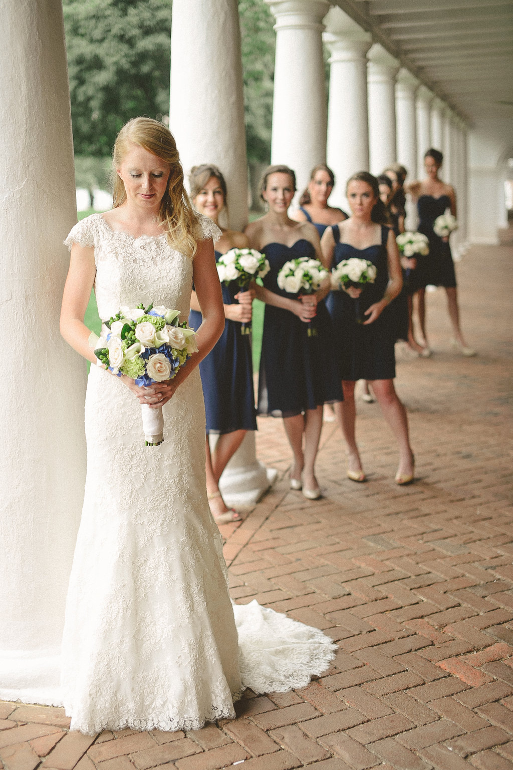 (bride and bridesmaids with bouquets)