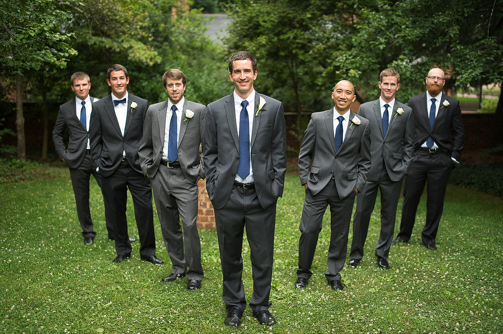 For the groom's boutoniere we matched the bride's calla lilies and for the groomsmen matched the bridesmaids with roses.