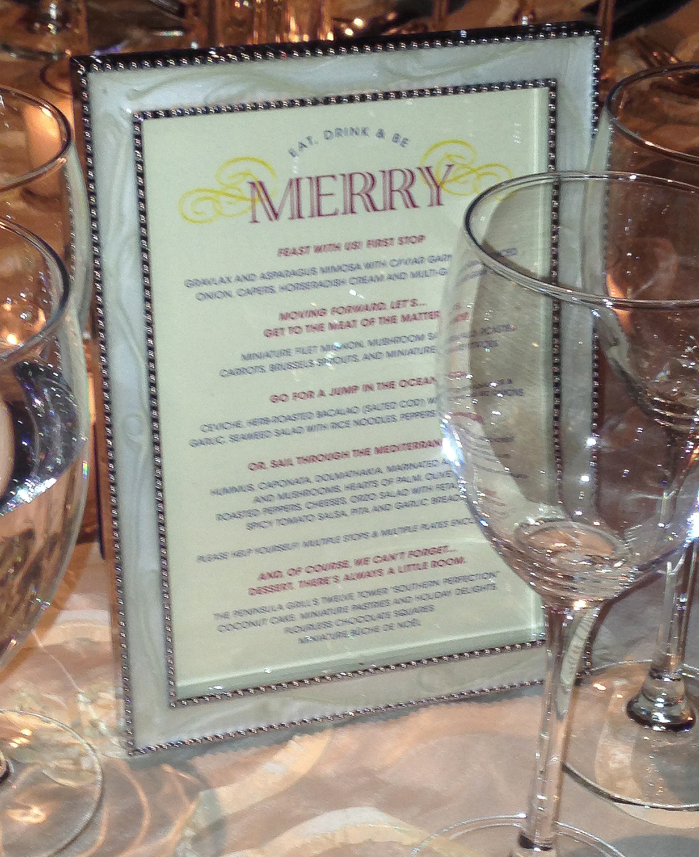 Menu cards displayed in beautiful frames at guest's tables to inform them of the delights that they are about to eat. The design carries the theme of the other wedding materials through to complete the ensemble of pieces.