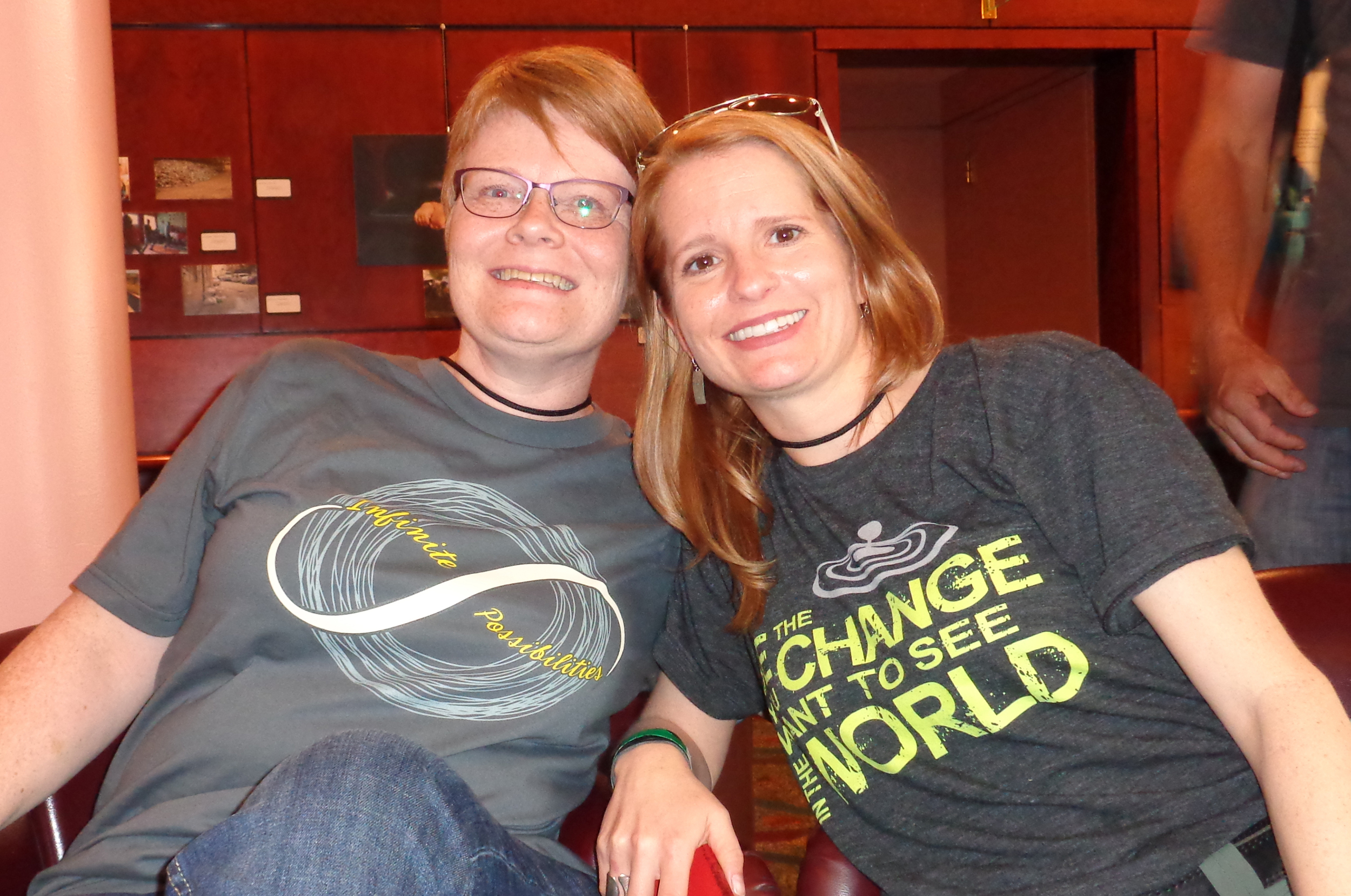 "Two of my amazing friends, Melanie and Dorene, from the   Rock Your Purpose Live (RYPL)   community each sporting T-shirts that I designed and created for both the RYPL community (""Infinite Possibilities"" T-shirt) and my community as well (""Be The Change You Want To See In The World"" T-shirt)."