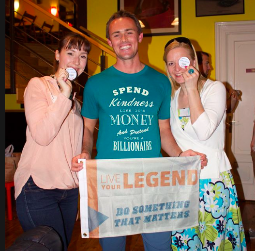 This picture warms my heart: Scott proudly wearing the T-shirt that I designed for him and his LYL community and holding a flag that he intended to hold high above his head after he climbed Mt. Kilimanjaro with his wife Chelsea.
