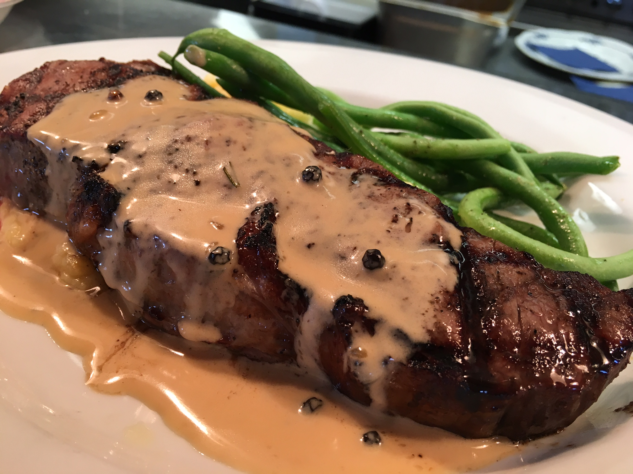 CK Strip Steak with Peppercorn Cream Sauce