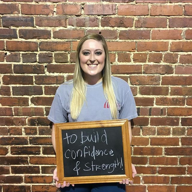 "#whyiCrossFit Kelli Sheridan ""I am 23 years old and I graduated from the University of South Alabama in May of 2016 with a Bachelor's degree in Health Care Management. I started working at Premier Family Health Care shortly after in July of 2016. After I gradutated college and moved back home I almost feel like I was starting to fall into a ""slump"". I feel like I mostly just went to work, and then came home and really didnt do much else. During that time I gained around 15 pounds and just really wasn't feeling happy with myself and wanted a change and something like a hobby to start doing. In July of 2017 I joined Sand Mountain CrossFit and started going three times a week to the women's class they had recently started offerring. Over the last six months I have lost 8 pounds, and several inches, and I have been able to tell a HUGE difference in my body. I have always lived a relativley active lifetyle, I played volleyball for six years and have always enjoyed running. How I feel now is definitley comparable to how I felt in previous years playing high school sports- I have so much more energy!  I have never had much self esteem but I can honestly say that over the last several months I am happier with myself than I have been in a long time. I have gained so much self confidence. I feel stronger and love seeing results! It's crazy to me that when I started I would use the lighter kettlebells and weights and after coming to class for such a short time I wasn't afraid to add some weight to the bar or move up to a heavier kettlebell. Now I see people come in and join and start out usng the same weights I did before and it's exciting to see how fast other progress. It's also fun push myself off of the other people in class. My best friend also goes and we love to have some friendly competition during the workout and then afterwards sit down and try to catch our breath and think, wow that was really fun! It's always such a great environment, everyone is so encouraging and I have never felt judged at all, and no one is ever made to feel goofy when we learn new movements in class. My only regret is that I didn't start sooner. I hope that other people don't wait or ma"