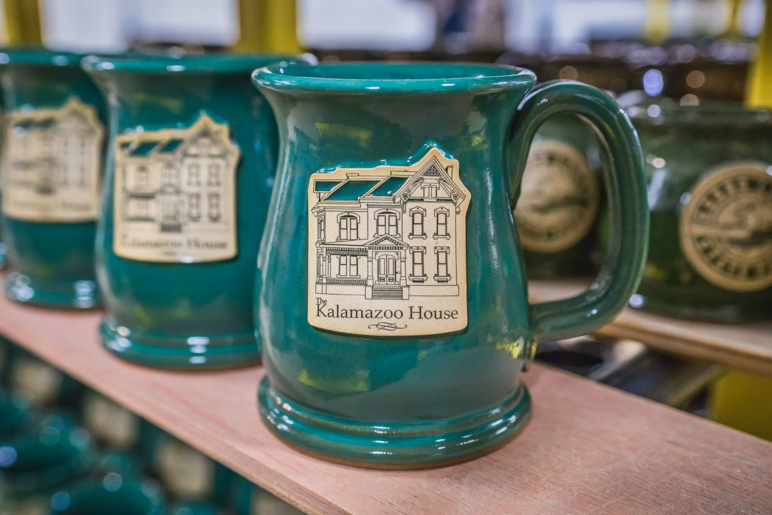 Cozy up to breakfast with your Kalamazoo House mug