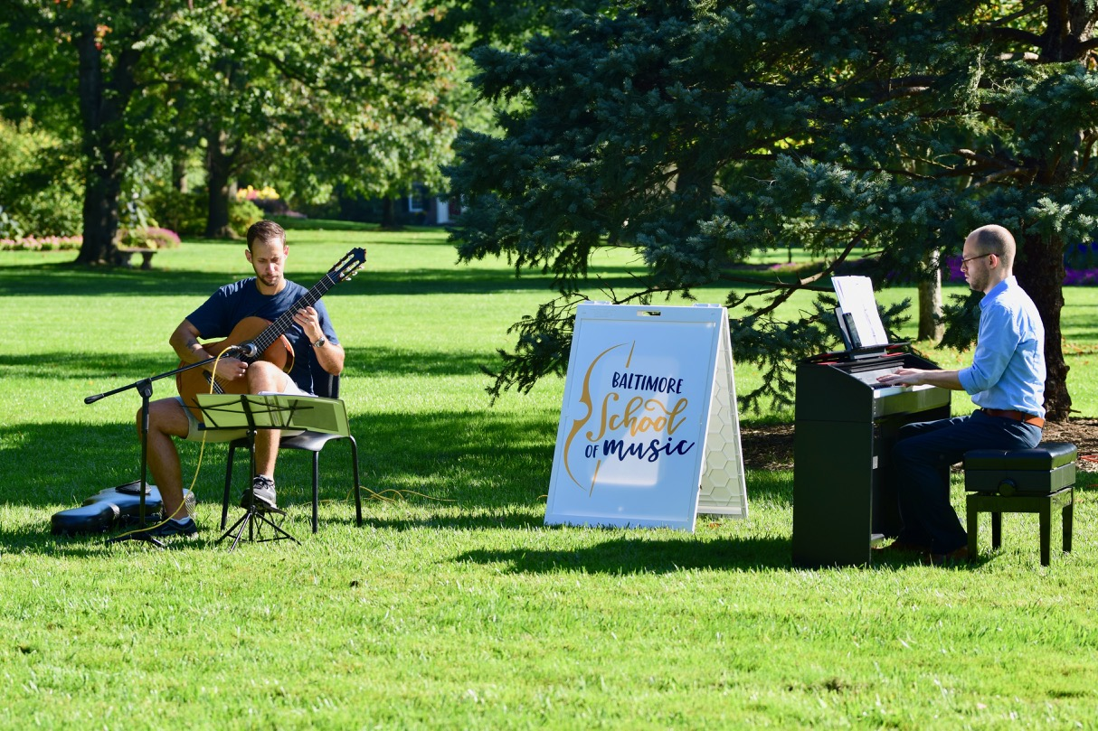 Performing Vivaldi Concerto in D Major in Sherwood Gardens for Baltimore School of Music's Music in the Gardens concert series.
