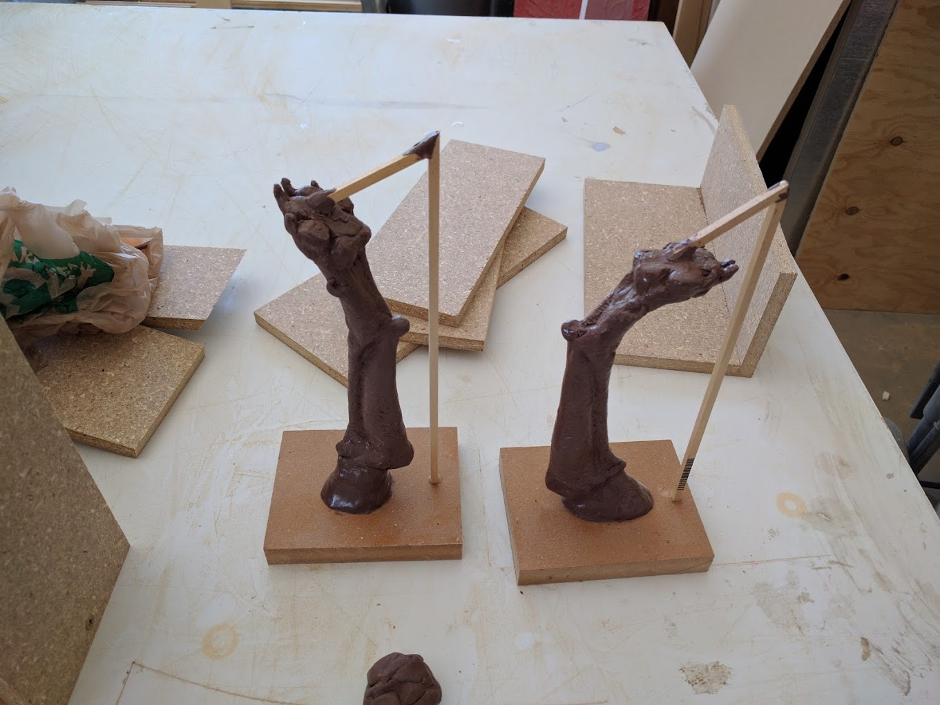 Front legs were cut. The wooden sticks will serve as exhaust channels when pouring the wax.