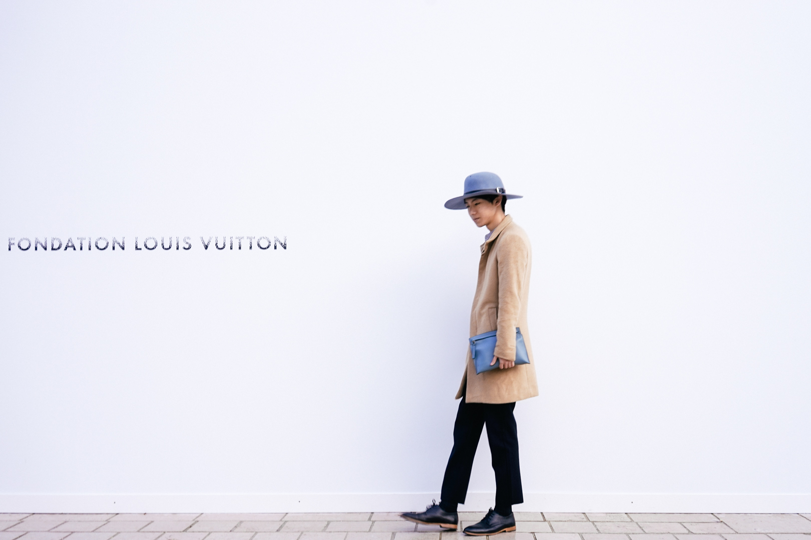 Hat from &otherstories; Wool Coat from Theory; Pouch from  Loewe ; Shoes from COS