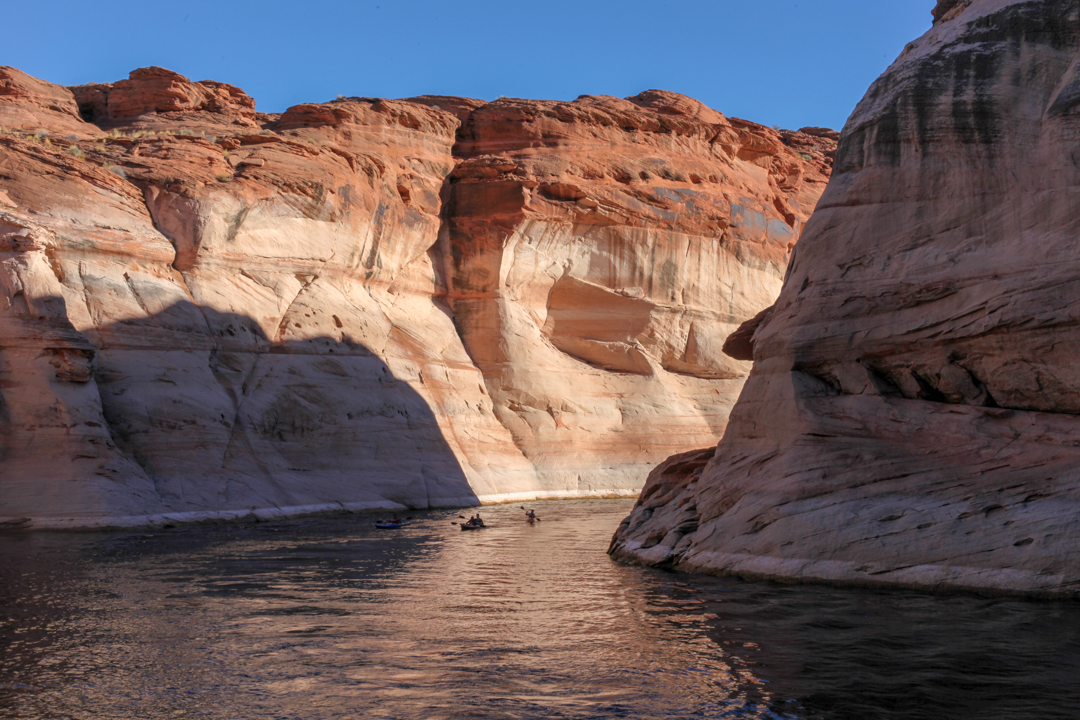 People kayak in the canyon