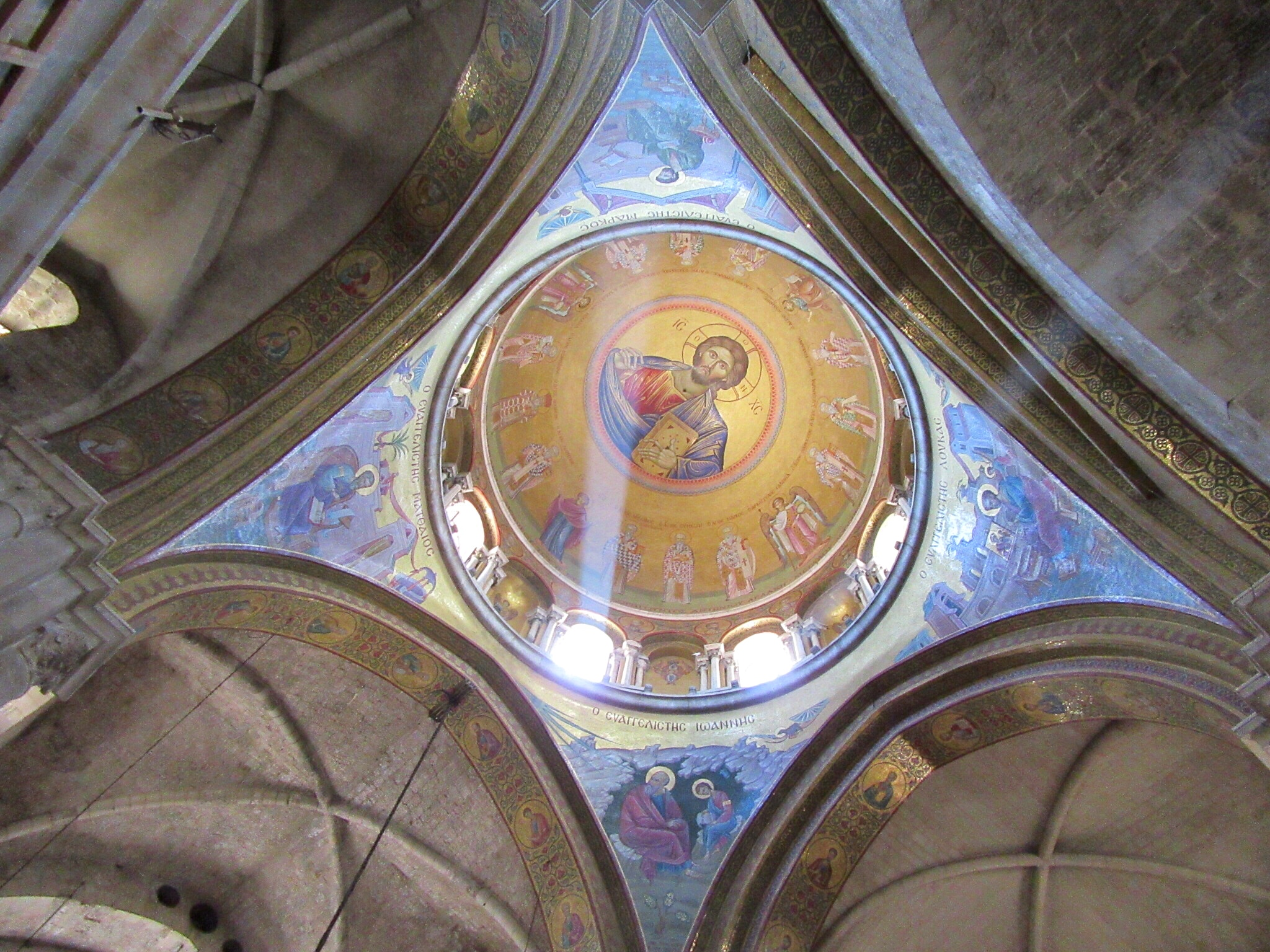 The Christ Pantocrator ceiling above the Catholicon in the center of the Church of the Holy Sepulchre.