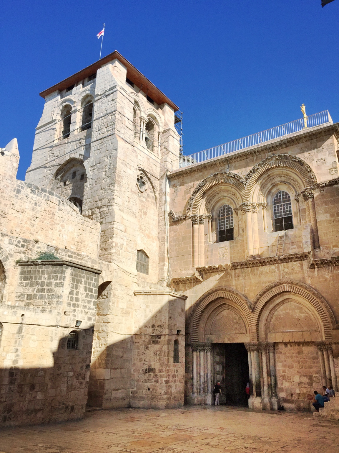 Entrance to the Church of the Holy Sepulchre. The immovable ladder rests against the upper-right window.
