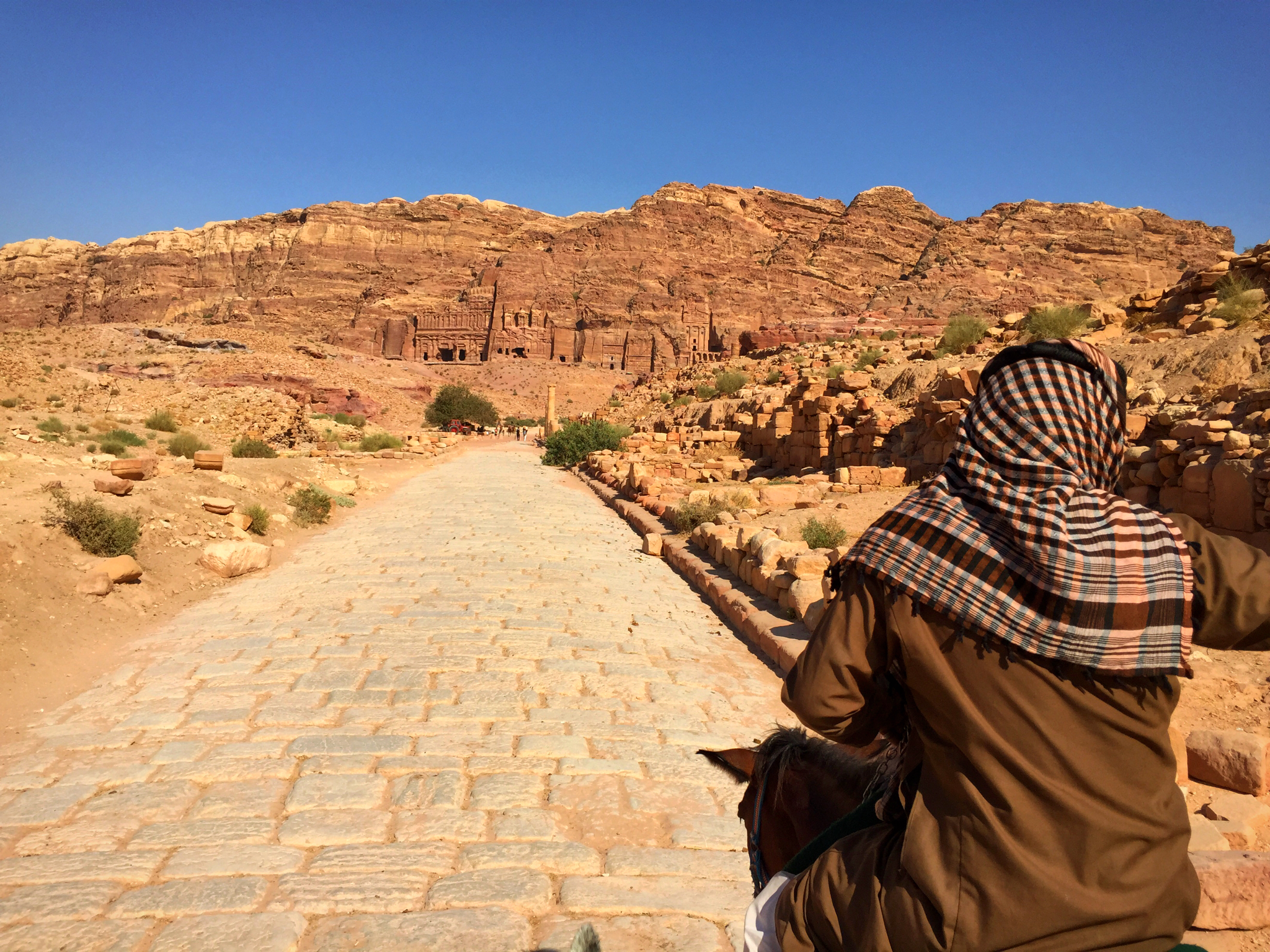 Bedouin guide leading along the Roman colonnade.