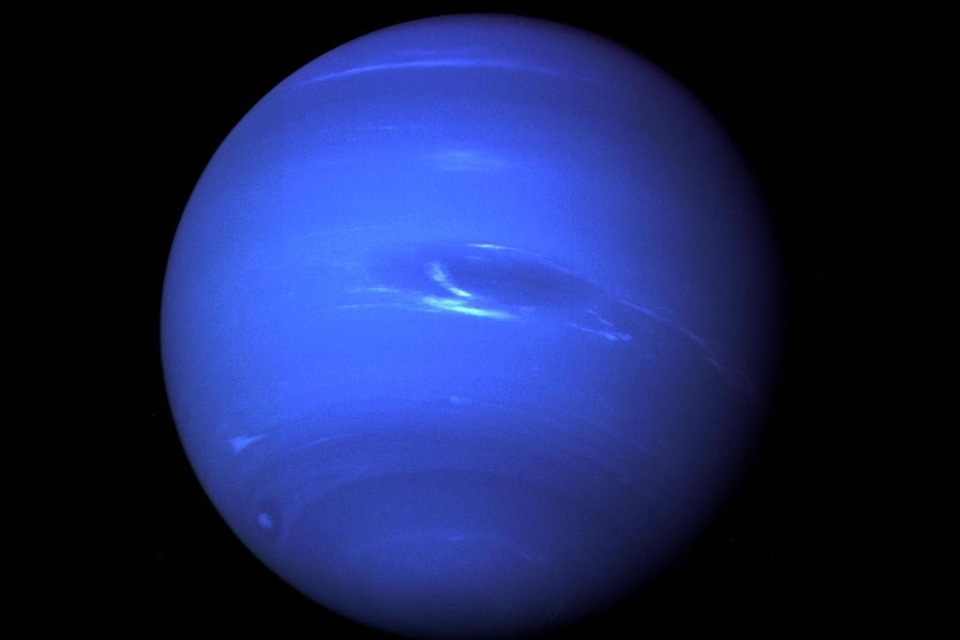 NEPTUNE AND ITS GREAT DARK SPOT - A MASSIVE STORM ROUGHLY THE SIZE OF EARTH