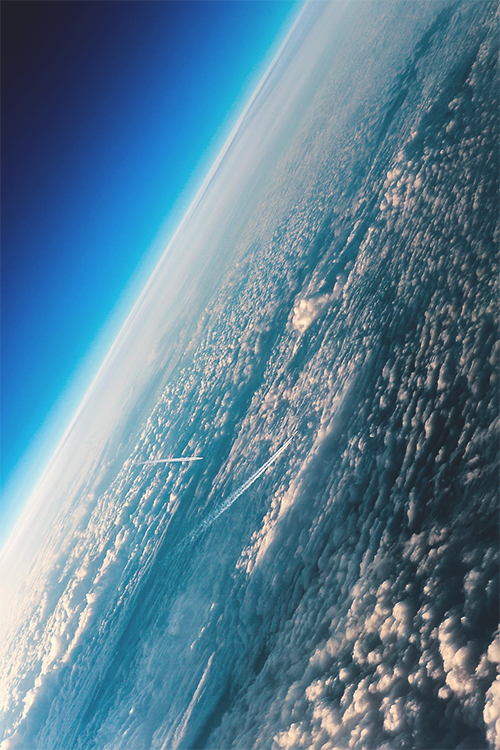A VIEW OF EARTH'S ATMOSPHERE, CAN YOU SEE THE JET TRAILS LEFT BY AIRLINERS?