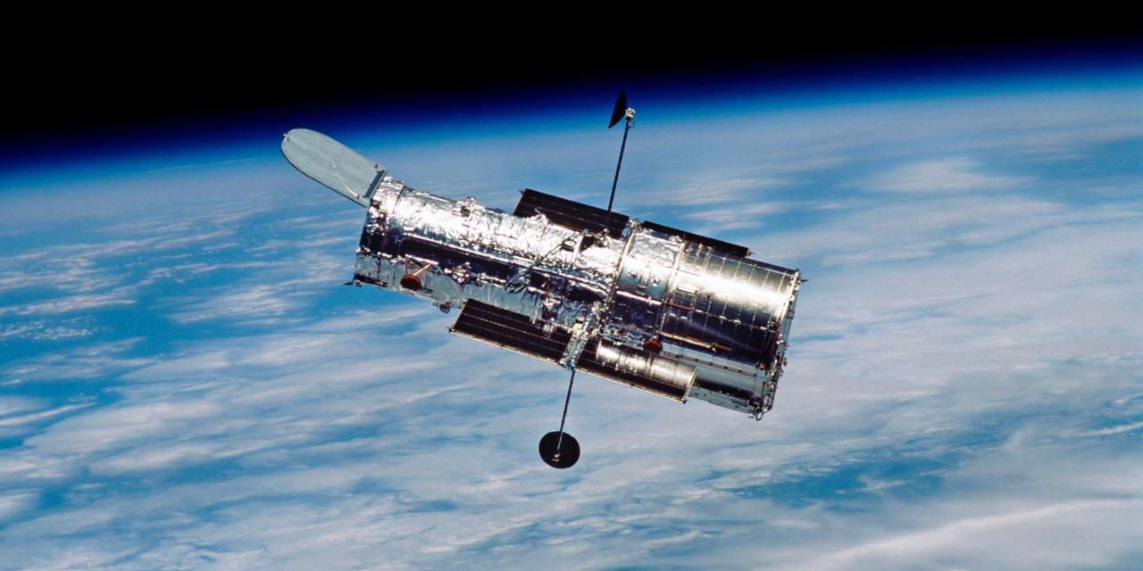 THE HUBBLE TELESCOPE IS A SATELLITE WITH A REFLECTING TELESCOPE, IT IS KNOWN FOR TAKING PICTURES OF FAR SPACE (SUCH AS THE PILLARS OF CREATION)