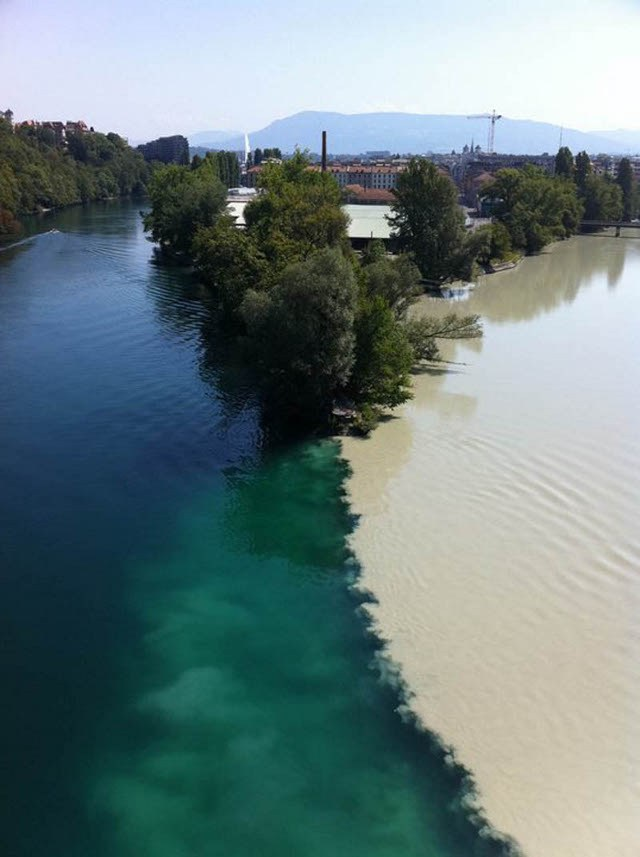RHONE RIVER MEETS ARVE RIVER, ARVE IS FED BY GLACIERS, WHILE RHONE IS FED BY A LAKE