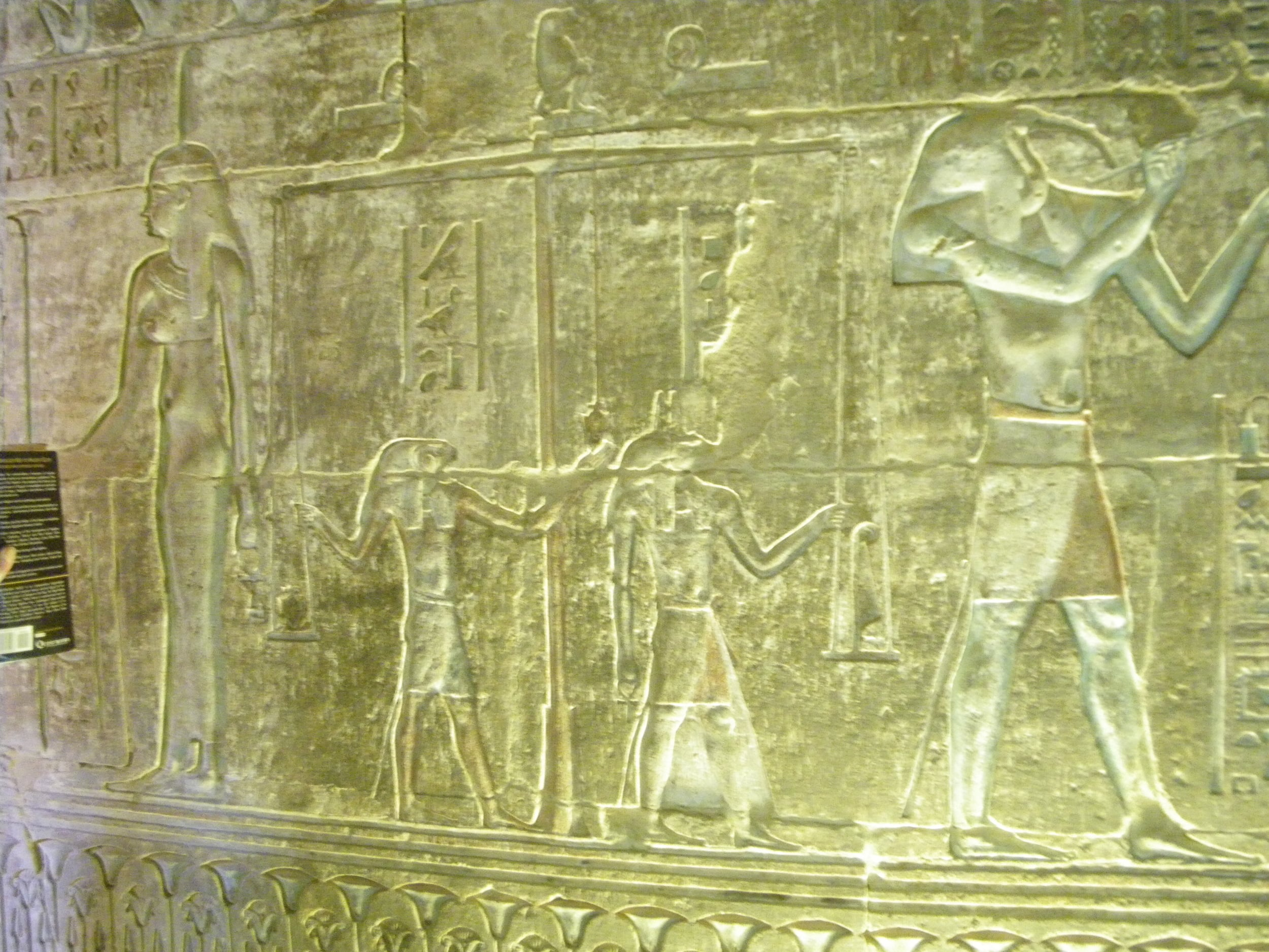 Figure 2. An image of the Weighing of the Heart theme from a Ptolemaic Tomb, Deir el Medinah, Egypt. From left to right are the neters/gods Maat, Horus, Anubis and Djehuty/Thoth. Sitting onto of the scales is a Hamadryas baboon representing Djehuty as A'an the principle of equilibrium.