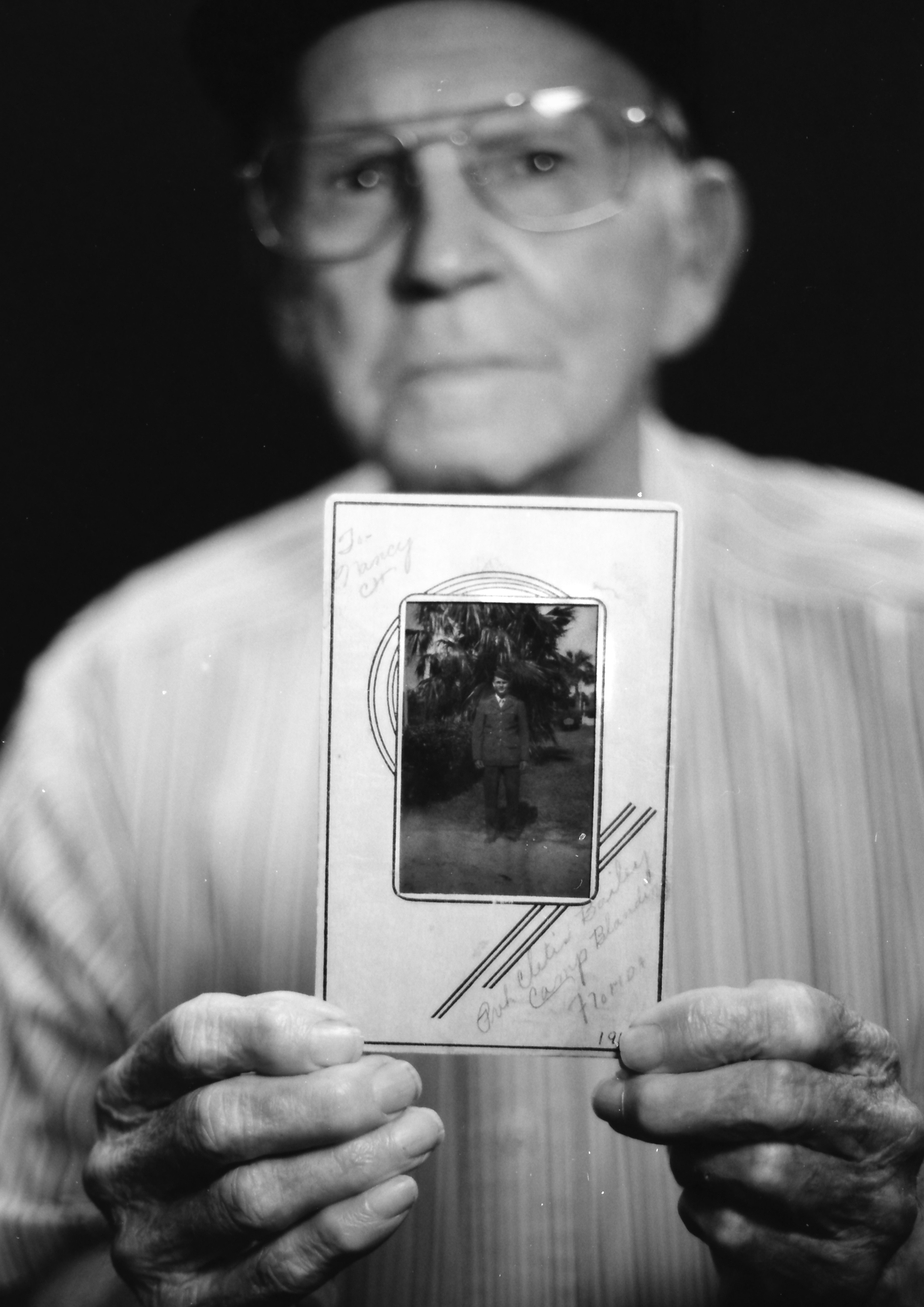 Master Sgt. Cletis Bailey - Air Force holding a photo from his younger days. Photo by Ricky Davis of TRD Photography - FIlm - Tmax 100